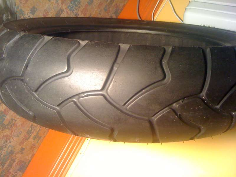 A motorcycle tyre being inspected