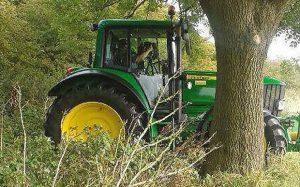 Police hide in tractors