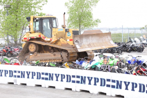 Watch: New York Police Department crush motorcycles with bulldozer to send message to 'knuckleheads'