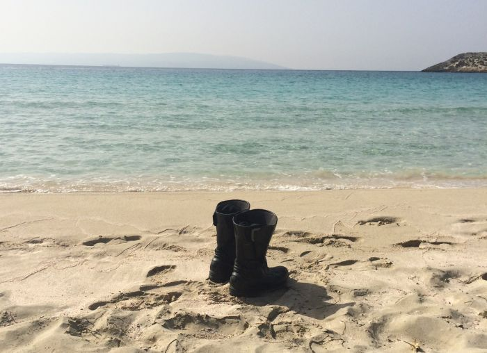 Motorcycle boots on a beach