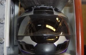 Watch what happens when you put a motorcycle helmet in a hydraulic press