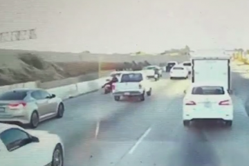 Pickup swerves into motorcyclist