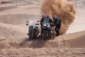 Riding sand dunes, Morocco