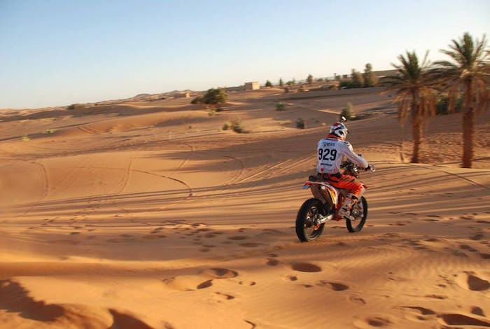 Riding a motorcycle in the sand in Morocco