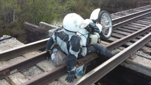 Holding the fallen motorbike