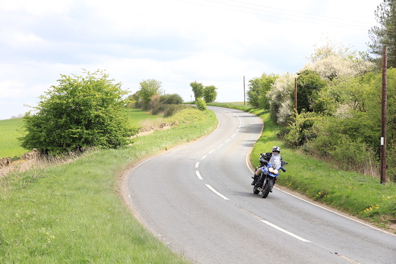 A motorcycle on a bend in the Cotswolds