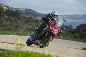 Honda X-ADV on a bend with the sea in the distance