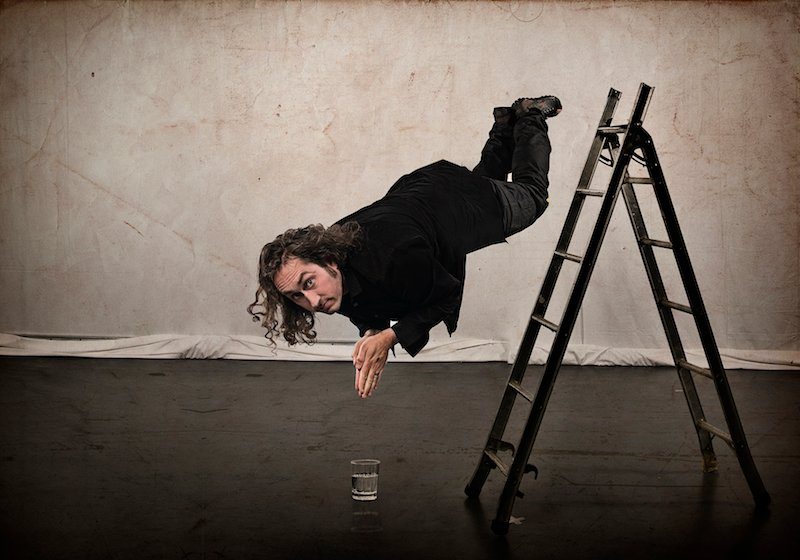 Ross Noble diving off a ladder
