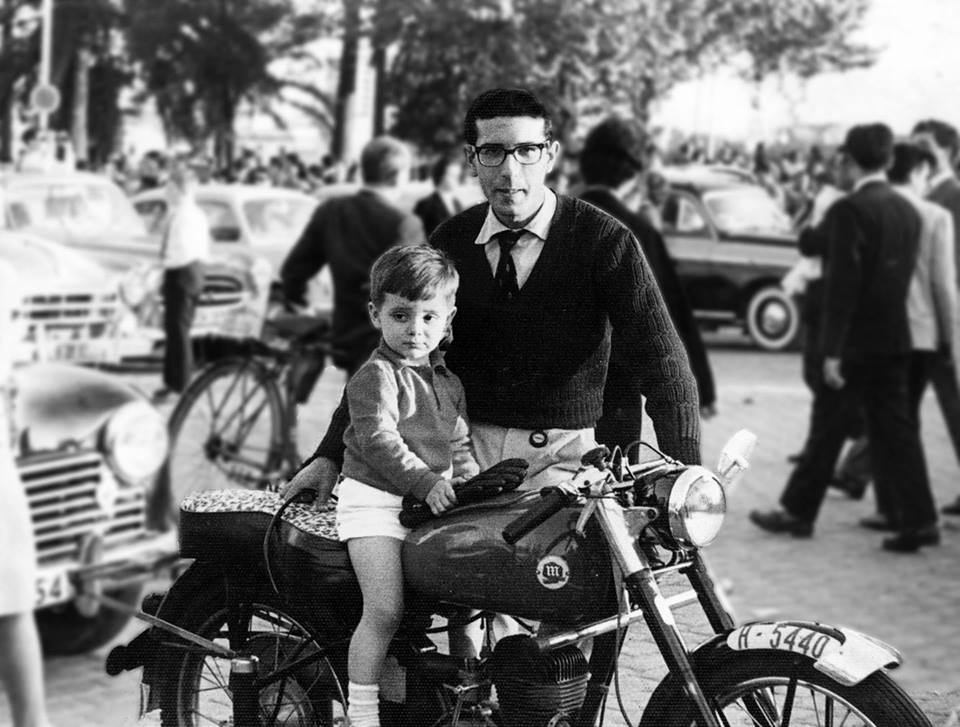Child on motorcycle with Father