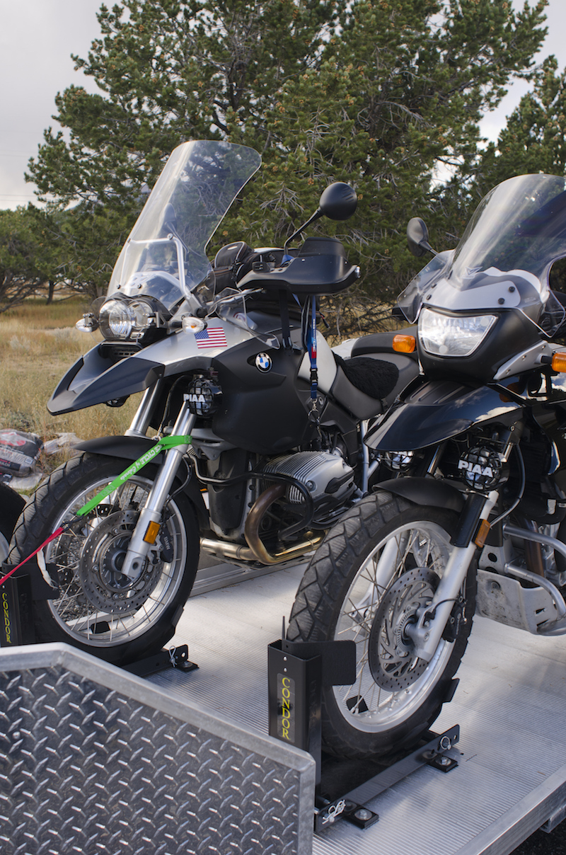 Two BMW motorcycles are loaded and tied down on a brand new motorcycle trailer