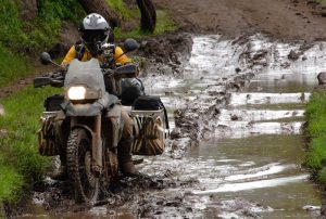 A motorcycle riding in mud