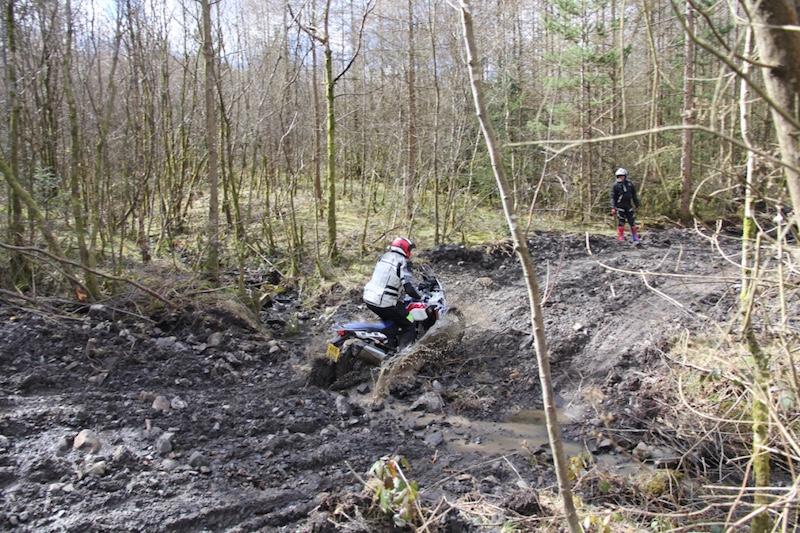 A Honda Africa Twin riding through mud