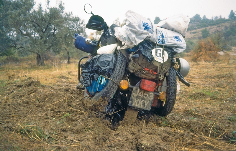 A motorcycle in a muddy field