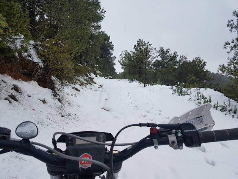 Riding a motorcycle in the snowy weather