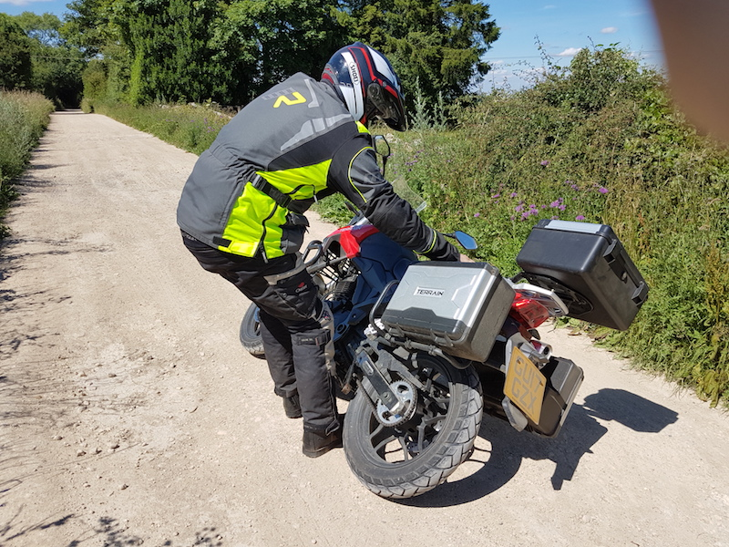 Picking up a motorcycle that has fallen over
