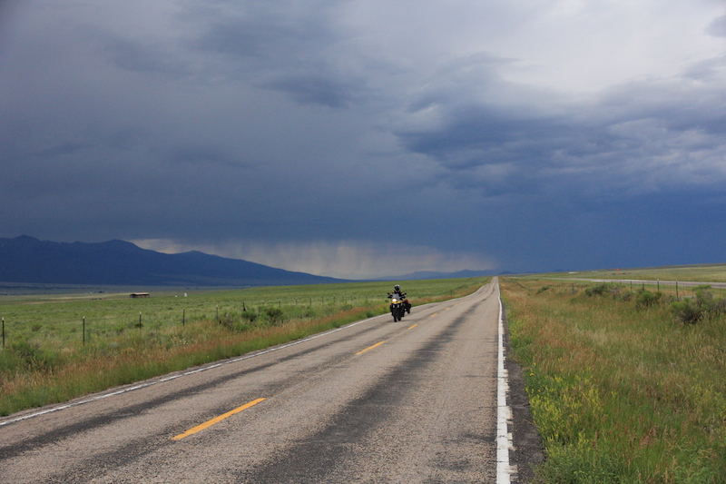 A motorcycle riding through storms in Colorado