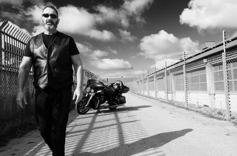 Alun Davies walking away from the Harley Davidson Ultra Limited