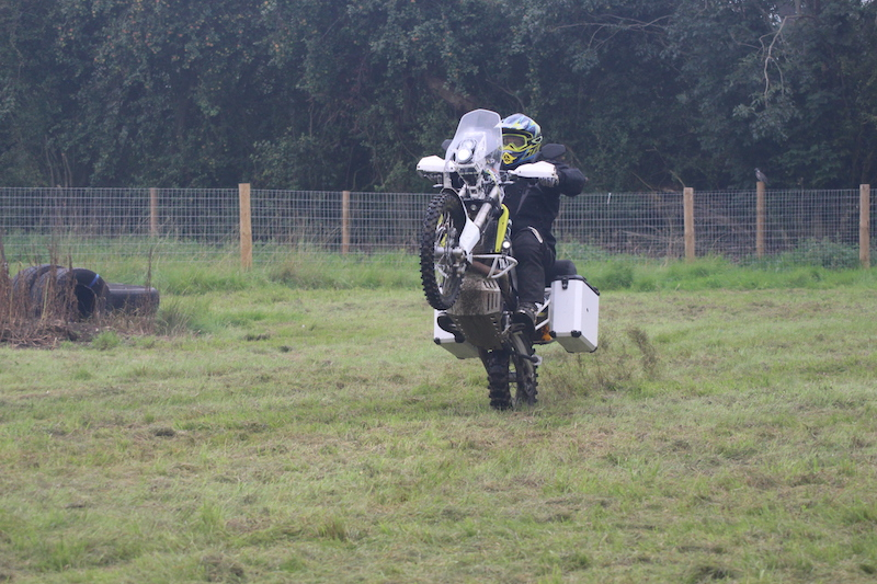 A Husqvarna 701 doing a wheelie