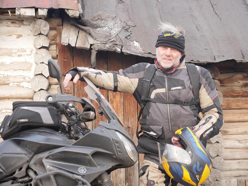 Nick Sanders standing with his Yamaha Tracer