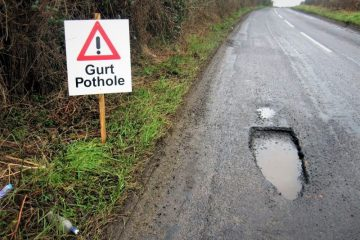 Pothole on road surface