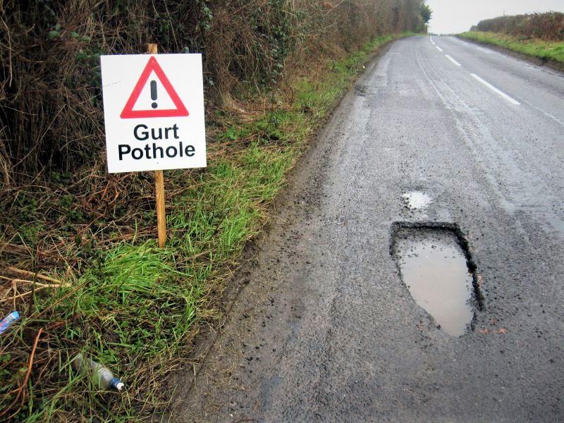 Pothole on road surface