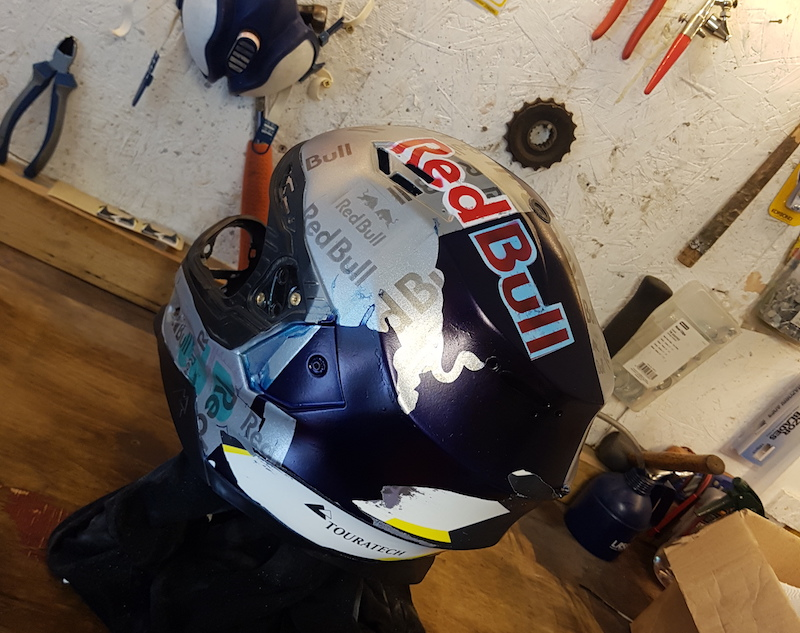 A half painted motorcycle helmet