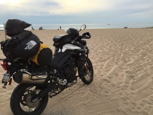 A Triumph Tiger 800 on a beach