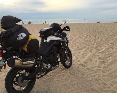 A Triumph Tiger 800 on a beach