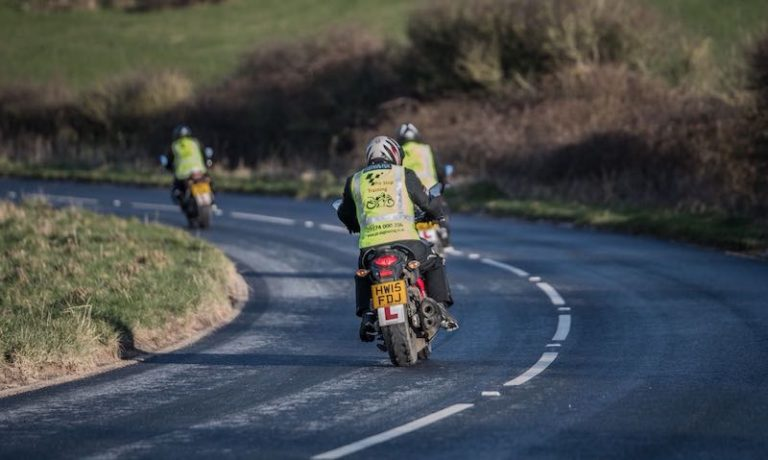 Two motorcyclists learning how to ride on the Isle of Wight
