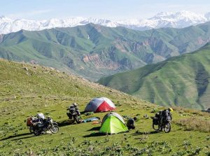 Motorcyclists camping Pamir Mountains