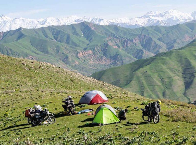 Motorcyclists camping Pamir Mountains