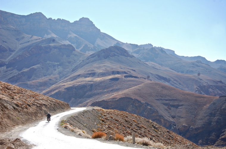 Motorcyclist riding mountains in India