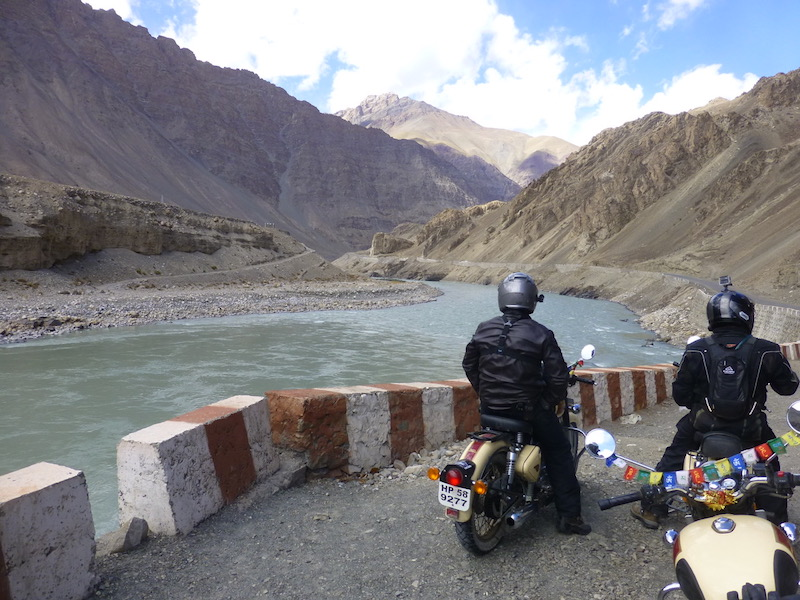Motorcyclist river India mountains