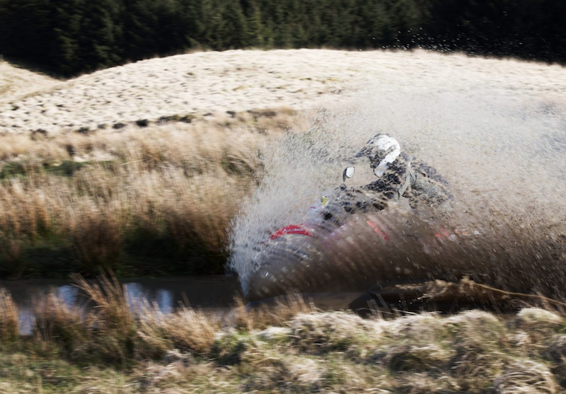 off-road motorcycle course riding through water