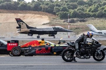 a motorcycle racing against a formula one car and a fighter jet
