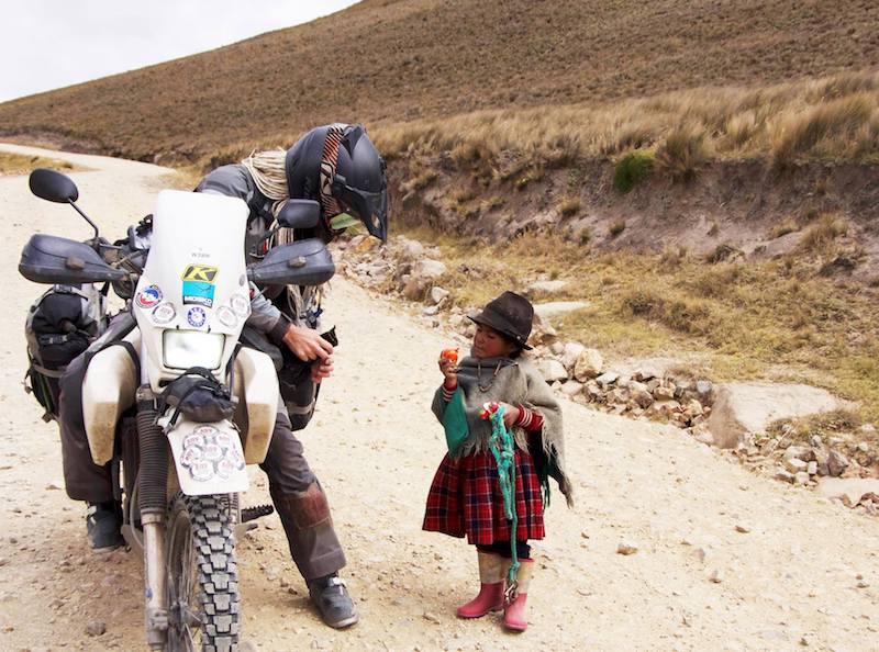 Egle Gerulaitytė and a local child in South America