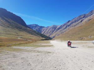 red ducati on mountain road in the italian alps