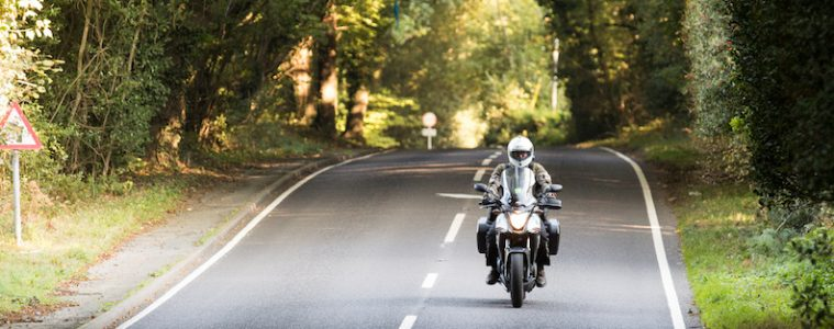 A motorcycle on a road in the South Downs