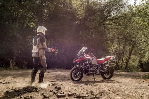 man walking towards BMW R 1200 GS fitted with Bridgestone tyres