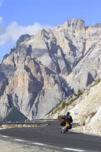 a ducati on a mountain road in the Dolomites
