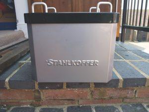 Stahlkoffer Aluminium Top Box on a wall