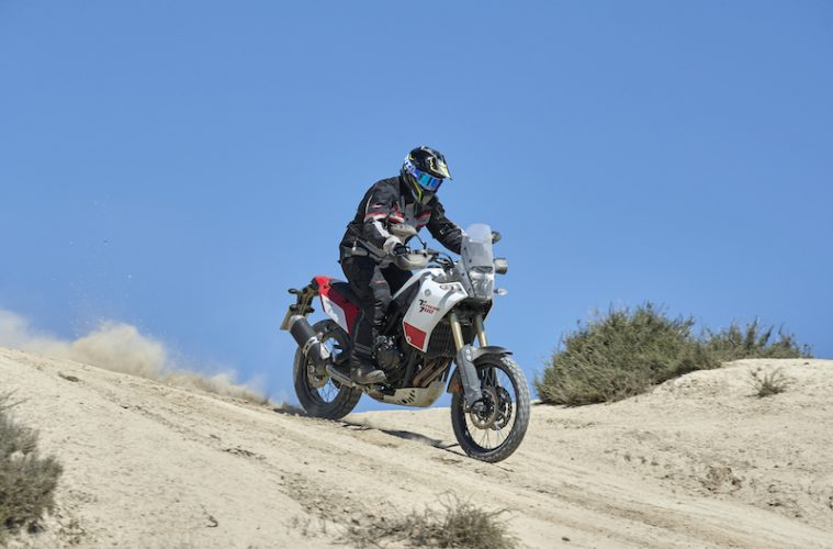 Red and White Yamaha Tenere 700 on a dirt trail in spain