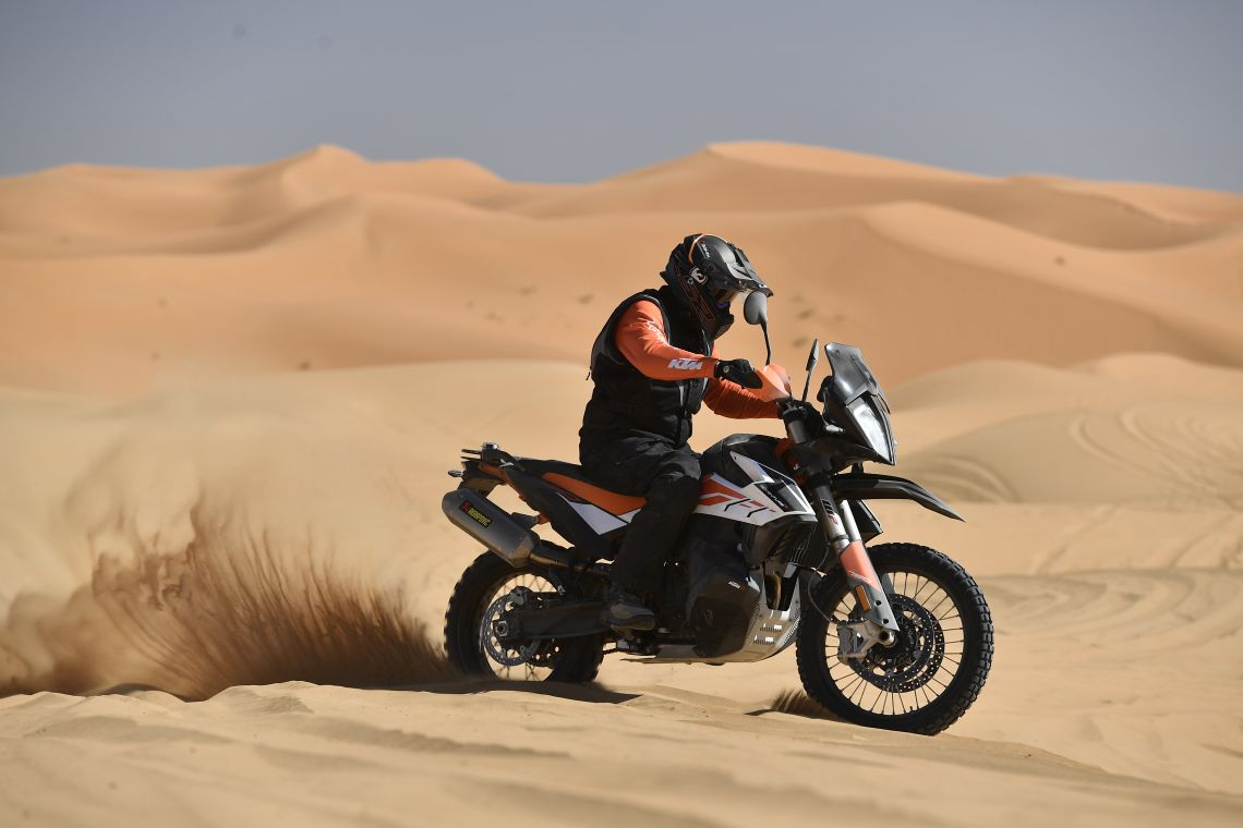 Riding through the fine sand