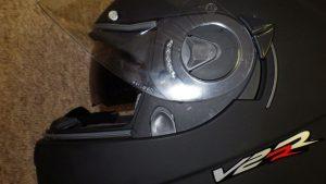 Visor release and inner sun shield lever