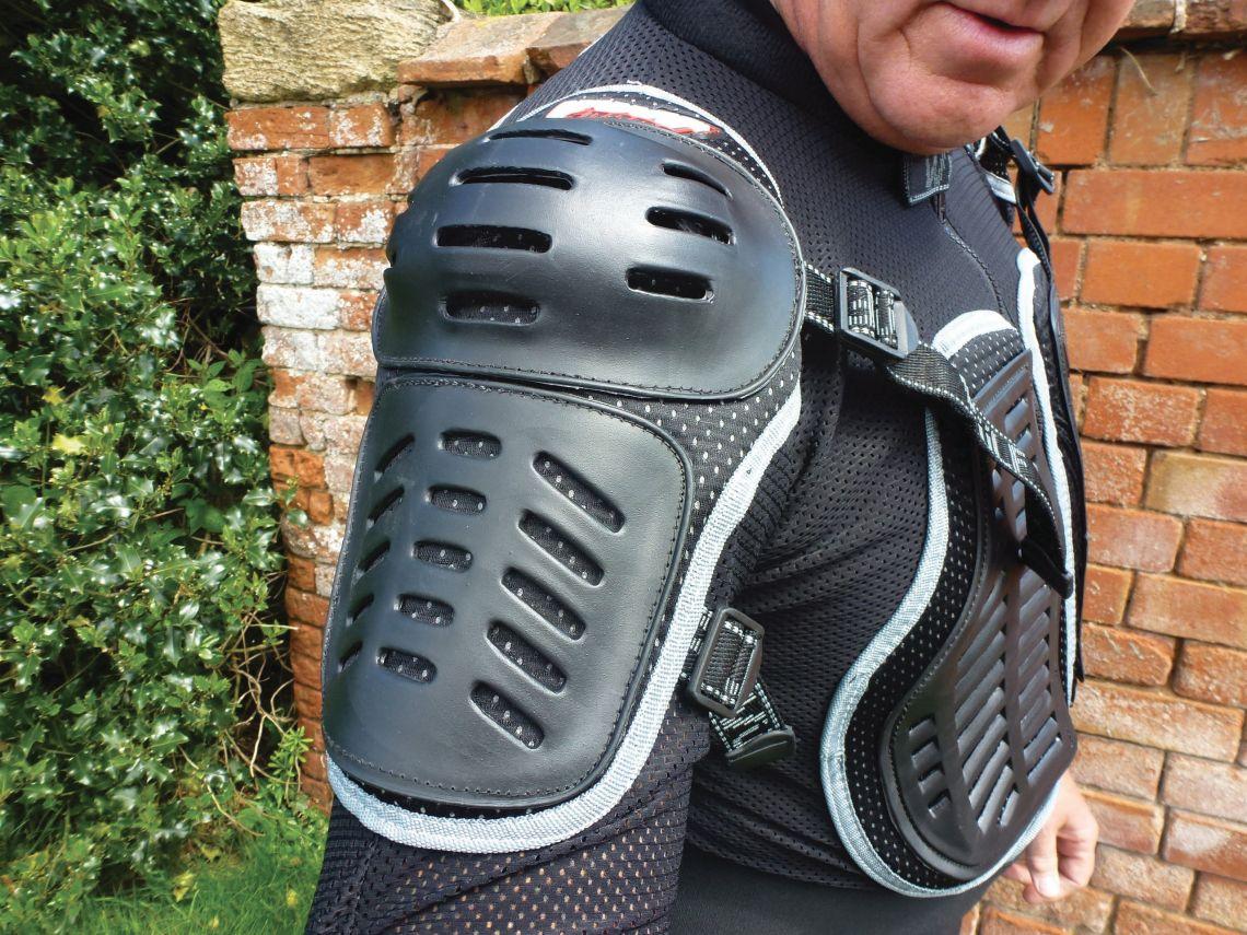 shoulder pad with adjustment straps